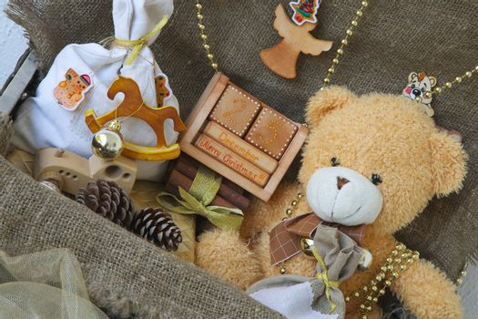 """A wooden made calendar with inscription """"December 25. Merry Christmas!!!"""" in an old case with other Christmas decorative items"""