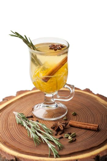 Traditional winter sweet hot alcohol drinks mulled white rum with orange, spices, cinnamon, rosemary, anise served on wooden board