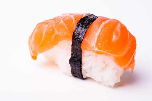 salmon sushi with nori isolated on white background