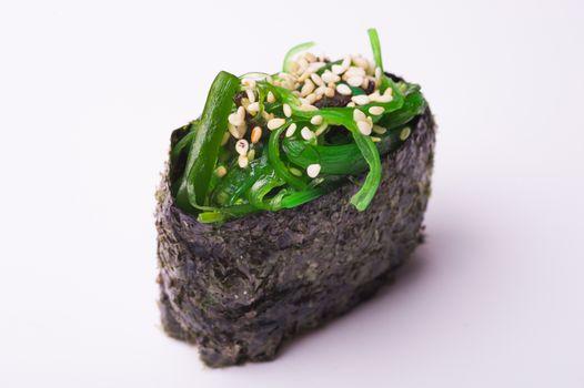 Close up of gunkan sushi isolated on white background
