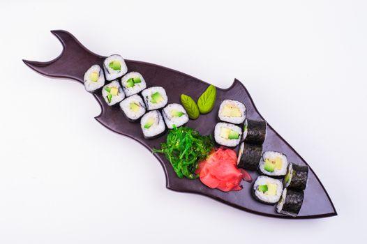 vegetarian sushi set served on plateisolated on white background