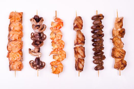 set of different meat skewers  isolated onwhite background