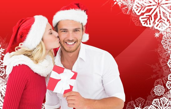 Young festive couple against christmas themed snow flake frame