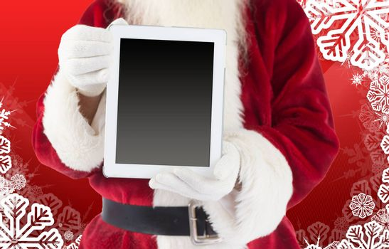 Santa claus showing tablet pc against christmas themed snow flake frame