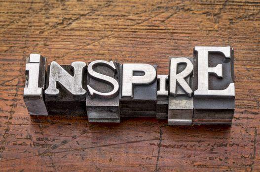 inspire word in metal type