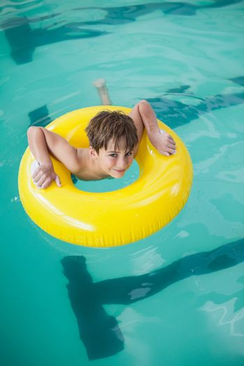 Little boy swimming with rubber ring