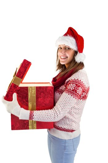 Girl opening a magical christmas gift