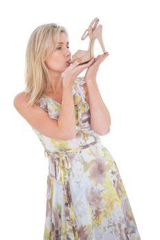 Elegant blonde admiring a shoe
