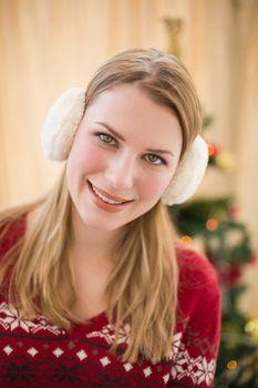 Portrait of a smiling blonde wearing earmuffs