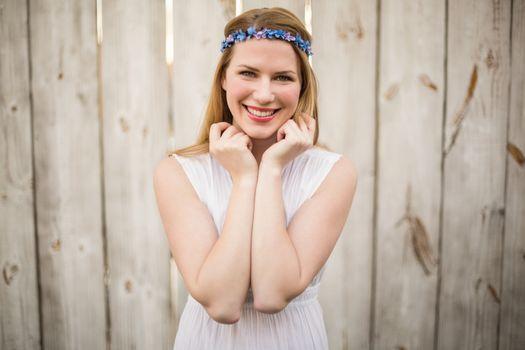 Smiling blonde woman wearing headband