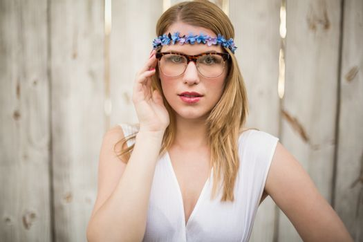 Portrait of a blonde woman wearing glasses and headband