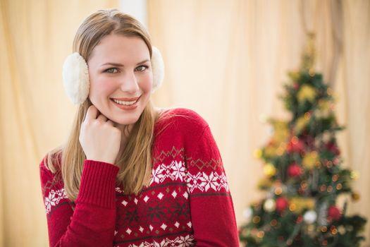 Portrait of a pretty smiling blonde wearing earmuffs