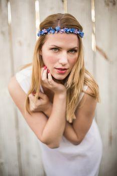 Pretty blonde woman posing while wearing headband