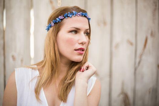 Blonde woman wearing headband looking away