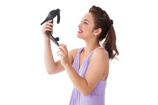 Elegant brunette admiring a shoe