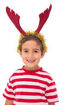 Cute little boy wearing antlers