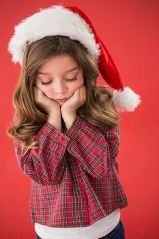 Sad little girl in santa hat