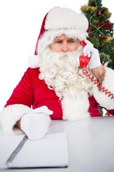Annoyed santa claus on the phone