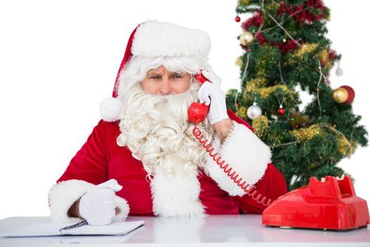 Irritated santa claus on the phone