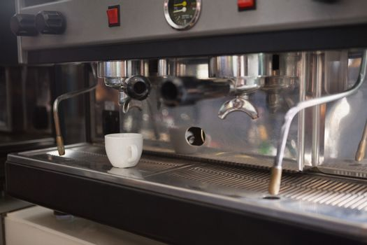 Cup of coffee on the espresso maker