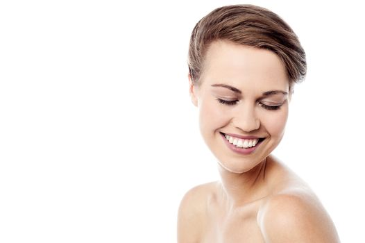 Shy woman with healthy skin