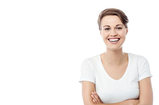Cheerful woman posing with folded arms