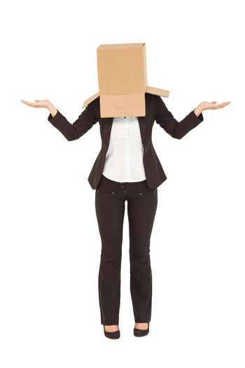 Businesswoman shrugging shoulders with box over head