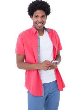 Happy causal man holding smartphone