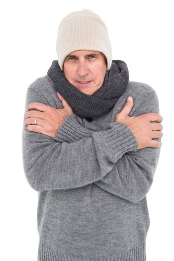 Casual man shivering in warm clothing