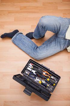 Man legs with toolbox on floor