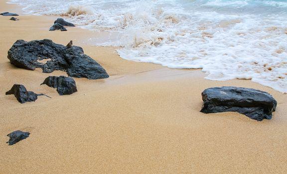 Volcanic rocks on the sands of Maui, Hawaii