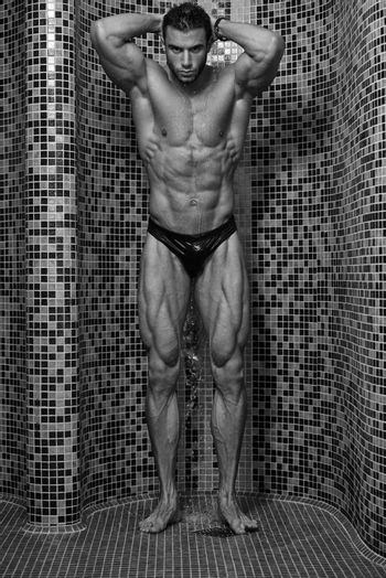 Young Good Looking And Attractive Man With Muscular Body Wet Taking Shower In Bath