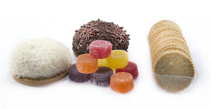 collection of delicious candies, biscuit and Cookies on a white background .
