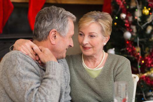 Loving mature couple with arm around