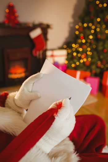 Father christmas writing list with a quill