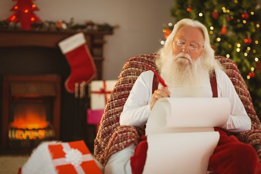 Relaxed santa writing list with a quill