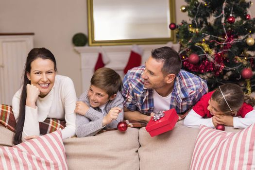 Peaceful family leaning on the couch at home in the living room