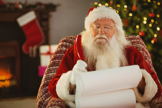 Santa claus writing his list with a quill