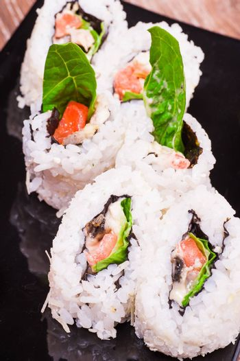 spicy sushi roll set  on wooden background