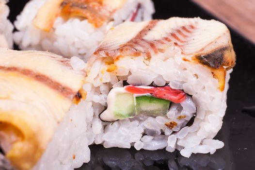 eel sushi roll set on wooden background