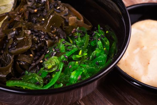 asian seaweed salad in bowl with nut sauce