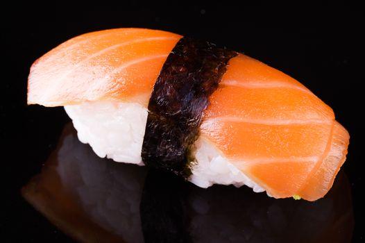 salmon sake nigiri isolated on black background