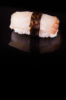 yellowtail hamachi  nigiri isolated on black background