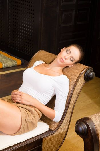 A young and happy female on holidays enjoying her hotel room.