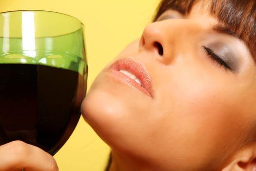 Closeup portrait of a latin woman holding a wine glass.