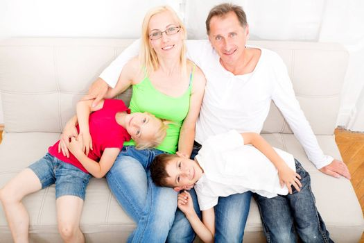 Happy family sitting together on the couch