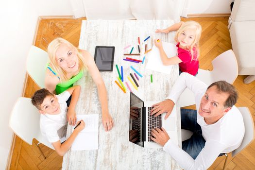 A family performing various activities at home.