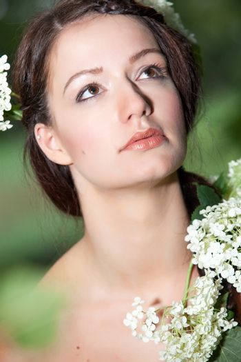 Young beauty woman in the forest whith beautiful looks