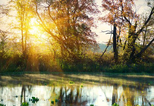 Bright sunrise over river