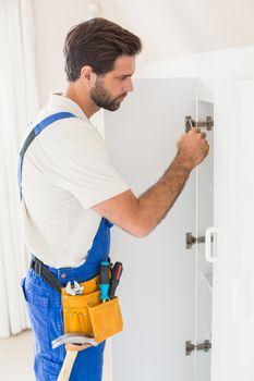 Handyman fixing a wardrobe
